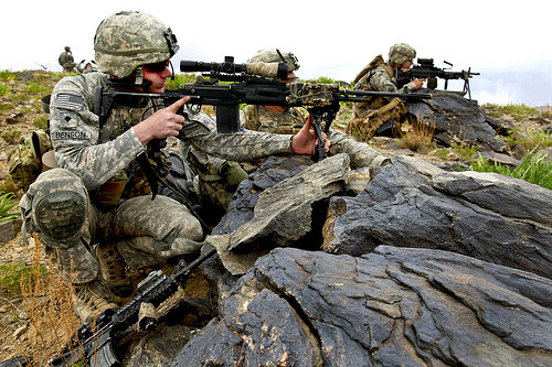 U.S. Army Soldiers provide security as a convoy passes through a valley in southern Wardak province, Afghanistan, April 29, 2010. The soldiers are assigned to the 1st Battalion, 503rd Infantry Regiment, 173rd Airborne Brigade Combat Team. U.S. Army photo by Spc. De'Yonte Mosley