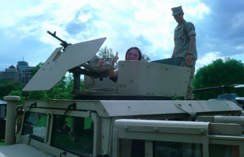 Day 11 — A photo of you taken recently: May 4th In the ringmount of a Humvee - the Marine said I was a natural. LOL. Sarcasm wasn't a good look on him.