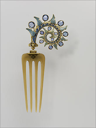 A 1902 to 1903 Lalique comb. I like that the decorative part of the comb is on a hinge so that it can be adjusted to show no matter how the comb is placed in the hair.