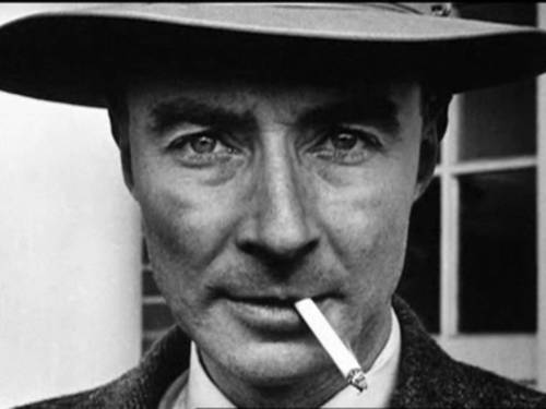J. Robert Oppenheimer, the most attractive scientist I've ever seen. Not only did he apparently smoke a cigarette while looking at random photographers like he could make them moan with just the lustful intensity of his gaze, he was also a total badass. He went to Harvard, and then he went to Cambridge, where he doused an apple in toxic chemicals and left it on a desk for his lab tutor to munch on, and presumably die from. His tutor didn't die (evidently not a fan of apples), but Jesus Christ. Talk about a bad boy. And then he like, invented the nuclear bomb and shit. I bet he could split your atoms all night. If you know what I mean. You'd be working with the force of nuclear explosions between the sheets.