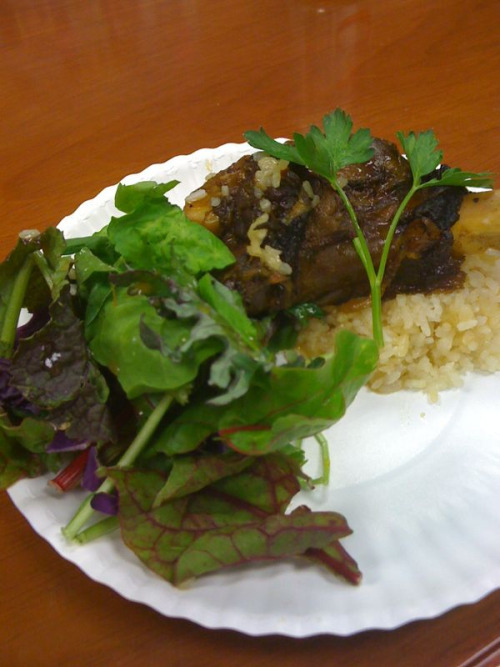 Braised local lamb shank over rice with a salad. I don't think I should eat something with such a large bone at work. Some prissy bitch got freaked out.  But then again, maybe I should. Muhahaha.