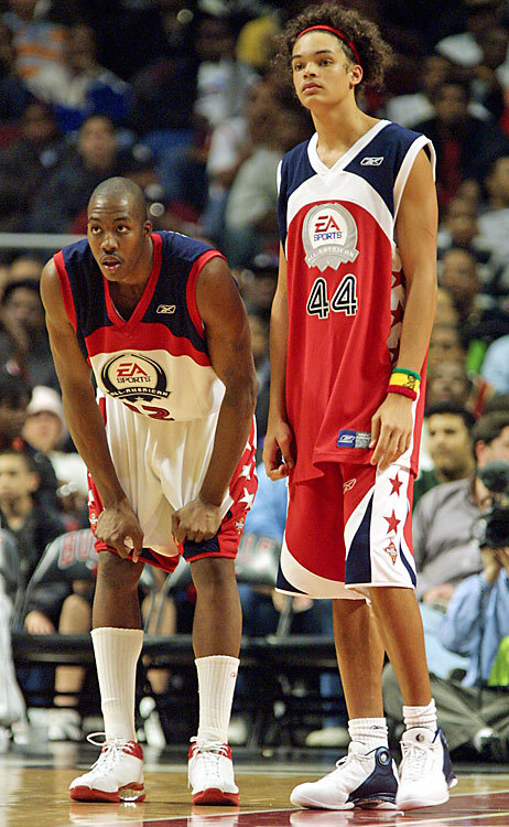A young Dwight Howard next to a pretty young girl… wait, who?! Three Bs.