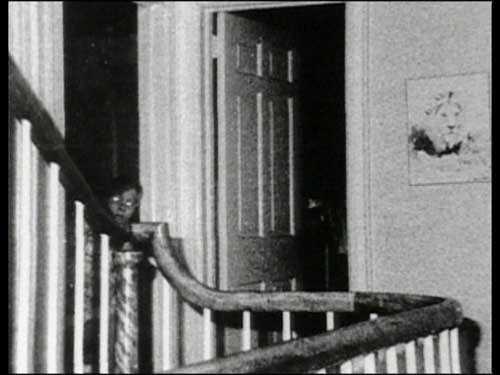 "Amityville massacre The first time that picture was shown was on the Merv Griffin show back in 1979. It was discovered 3 years after it was taken. Gene Campbell, who was a professional photographer, was brought into the house in 1976 when the Warrens went in with their team. He set up an automatic camera on the 2nd floor landing that shot off infrared film, black and white, throughout the night. There are literally rolls of film with nothing on them. There's only one picture of the little boy. In 1979, I was putting together a book that has yet to be published that included the photographs. The secretary I had at the time was about eight months pregnant. We had dozens of these pictures to choose from that didn't have the boy, and she asked me: ""Which one should we put in the book?"" I told her to just pick one. She came running back into my office about 5 minutes later saying that every time she picked up the photograph with the boy, the baby kicked her. We then asked my kids if they knew who this was. Missy said it was the little boy she used to play with in the house. I then called the Warrens and the photographer and let them know about the picture."" [source] [whole story]"