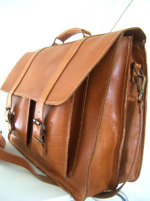 Q and Answer: How to Care for a Leather Bag An anonymous emailer asks: I've got a leather shoulder bag that I use a lot. how should I be  maintaining it? Does it need to be polished, too? Generally speaking you won't need to polish a bag - shiny isn't the adjective you usually want attached to your luggage.  For the most part, care for a leather bag is simple.  Once a year or so, clean it with some saddle soap.  If you feel like it, or it seems to be drying, rub it down with a bit of leather conditioner.  Be aware that this will likely darken the leather at least a little, but it'll be in a nice way.  Enjoy it. If your bag scuffs, a bit of polish can help cover it, just remember that there's no need to buff.  If your bag gets damaged, a shoe repairman (who does purse repair) is the man to see.