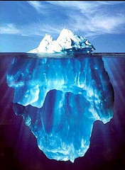 The artist combined an Antarctic iceberg, an upside-down Alaskan iceberg, the sky, and the background to create his vision. ~ Ralph A. Clevenger, 1999:   Fake
