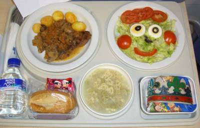 "That was the menu served to the children on the 6th of January ""Three Kings' Day"" (the day that children receive gifts in Spain). There were a funny salad, an amusing soup, a beef  steak with mushrooms ang potatoes, and typical spanish Christmas desserts called ""Turron"" and ""Roscon de reyes"". The menu made the children smile! Vall Hebron Hospital, Barcelona (Spain)"