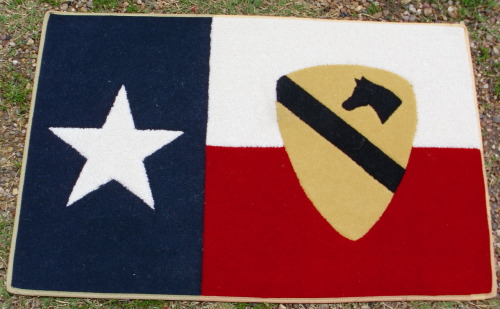 The 1st Cavalry patch inset in the Texas flag. Almost brings a tear to your eye.