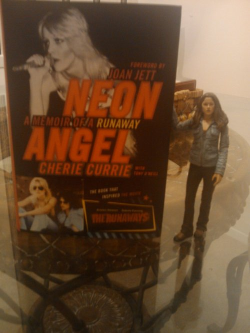 "I'm reading Neon Angel because I'm currently obsessed with Kstew's movie ""The Runaways""! Anyone want to start an all girl rock band?"