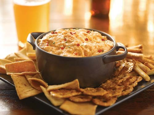 "Buffalo Chicken Dip This recipe is billed as ""buffalo wings in dip form,"" and I'm not sure how I feel about that. I love buffalo wings (especially with Frank's red hot), and I love dips of all sorts…but this? I guess I'll have to try it and find out!"