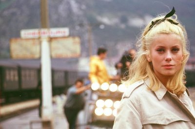 Catherine Deneuve on the set of The Umbrellas of Cherbourg (1964, dir Jacques Demy)