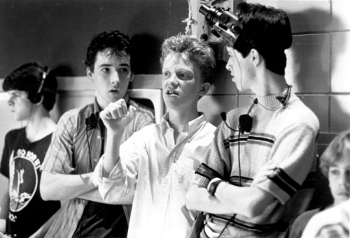 "John Cusack + Anthony Michael Hall + Darren Harris shooting ""Sixteen Candles,"" 1984."