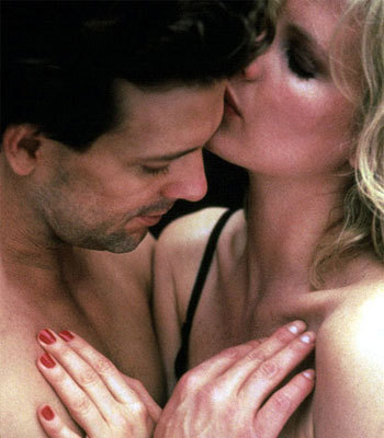 "Kim Basinger + Mickey Rourke in ""9 1/2 Weeks,"" 1986."