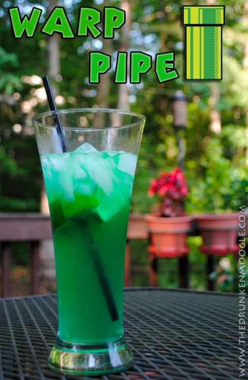 Warp Pipe (Super Mario Bros. Cocktail) Ingredients:3/4 shot Blue Curacao1/2 bottle Mike's Hard Limeade1/2 shot Bols Melon1/2 Lime (cut into wedges) Directions: Cut your half a lime into four wedges.  Squeeze the lime juice into a highball glass and then drop them in the bottom.  Add some ice overtop the limes, then pour in the Blue Curacao.  Add the Mike's Hard Limeade until the glass is almost full, then top with your Bols Melon.  Stir a bit with a straw and enjoy.  Tip: make sure you don't add too much Bols Melon, or the melon flavor will overpower the lime.  This is a great summer drink! See how far the warp pipe goes… (Drink created and photographed by Mitch Hutts of The Drunken Moogle)