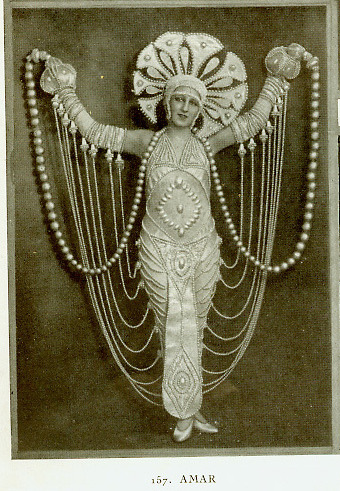 "(from the ""mysterious headdress lady"" files) ""Look ma, no hands!"" / From La Revue des Folies Bergere, 1924. costumes designed by Erte. (via eliz.avery)"