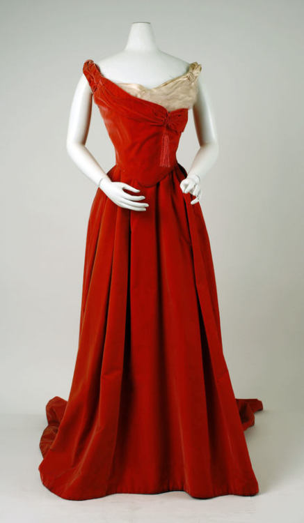 A red velvet Worth ball gown dating between 1898 and 1900.