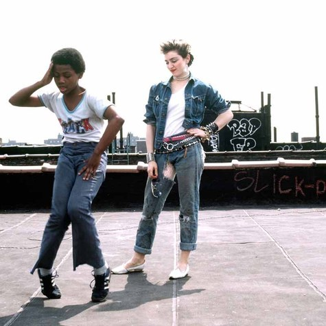Madonna on rooftop with neighborhood kid, NYC, 1983. Photo by Richard Corman