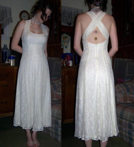 This is a Hand Sewn Wedding DressSewn by me!My mom gave me  some great vintage fabricsand being an off white/ivory color I  decided to make a wedding dress.I hope you like it!The lace  is perfect, no holes, snags or spots.The fabric I used for the sewn  in slip does have a spot or two but you can not see it under the lace.It  has never been worn aside from me in the pictures and my sister who  I used as a mannequin while making it. Hand Sewn TeaLength Beach Wedding Dress w/ Vintage by AknieGirl