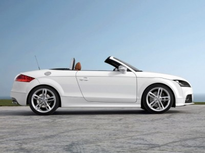 Audi TTS Roadster Audi is taking the wraps off a new sports car - the Audi TTS, the top of the TT model line. It will be coming to dealer showrooms in the early summer. Under its hood lies a two-liter TFSI high-performance engine delivering a mighty 272 bhp. This intense power propels the TTS Coupe to 60 mph from a standstill in just 5 seconds and on to a governor-limited top speed of 155. The Audi TTS is available as both a 2 + 2-seater coupe and as a roadster.