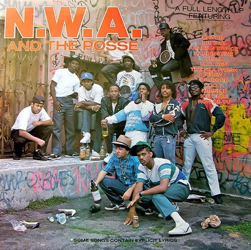 NWA and the Posse. The Rick James-hair, the big clock-necklaces, the unadulterated force of awesome that is Dre. This picture holds it all. Forever heroes.