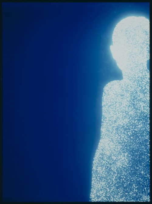 bababadalgharag:  Christopher Bucklow, Guest, 1995 To create this picture, Bucklow photographed the sun using a multiple pinhole camera constructed from a cardboard box. The apertures, punched out in a pattern, allowed him to make numerous, often thousands, of images simultaneously. Together, like atoms, these tiny images of the sun join to form a larger body—in this case, a luminous human figure, which happens to be the artist himself.