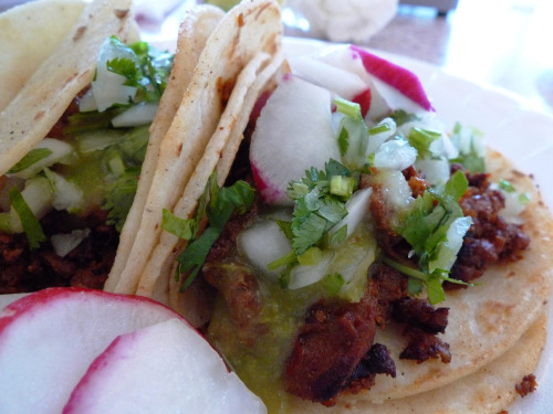the incredibly unassuming lily's taqueria is tucked away at the very edge of downtown santa barbara.  it's at the end of a dead end street right beside the freeway, and offers only a handful of items on its singularly focused menu (vegetarians beware).  but if you manage to find your way there, i promise you won't be disappointed.   while i'm not quite brave enough to try lip, cheek, tongue or eye tacos, the steak asada and pork adobada (spicy shepherd's style) varieties, garnished with radish, cilantro, onion and lime, are the stuff my food fantasies are made of. rich, tangy and piquant, once you have finished two or three of these little bundles, your mouth will be pleasantly burning and your appetite just whetted.  the only solution is another couple of tacos, and a chilled bottle of mexican coke with real sugar.  now, if only they had beer…