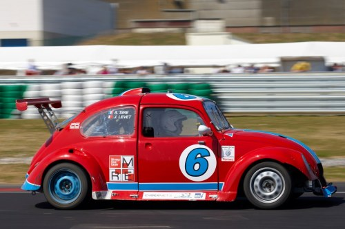 This is my 2010 funcup car in the Belgian Championship. Already some fine results, together with my colleague Jacques Levet. At the Mettet race - the first ever for cars on that track originally intended for bikes - we came 9th in a field of 40 cars. In Dijon we were joined by my stepson Joffrey David, who was racing a car for the first time, but who has unvaluable experience of go-karting at top level since he was 10. He made the fastest lap in the race. Since, our result in the Belgian race was quite disappointing due to a broken cardan. But we entered a heat of the french championship held thereafter, and came 6th overall (4th in heat 2). Funcup cars are now powered by a 175hp TDI engine, and with a weight of 850kg, can teach a top speed of 210 kph.