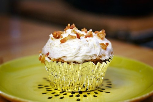 Maple Bacon Cupcakes  Recipe by vanillagarlic.comMakes 6 / 350F oven Ingredients4 1/2 tablespoons of butter, room temperature  1/2 tablespoon of bacon drippings (left in the fridge to become solid) 1 egg  5 tablespoons of brown sugar  4 tablespoons maple syrup  1 1/4 cup of self rising flour  1 teaspoon of baking soda  1/2 teaspoon of baking powder  tiny tiny pinch of kosher salt  1/4 cup of milk  1/4 cup of minced bacon, cooked and drained  DirectionsCook some bacon in a fry pan (about 6 thick strips). Reserve the drippings and place in the fridge to solidify. Mince 1/4 a cup of the bacon. The chef should eat whatever is left to assure that the bacon is tasty. Beat the crud out of the butter and solidified bacon fat 'till light and creamy. Add the brown sugar and maple syrup and beat well until combined. Add the egg and beat until incorporated. Sift the flour, salt, baking soda and powder together. Add some of the flour and mix, then some of the milk, then continue to alternate the dry and wet ingredients, ending with the dry. Mix until just combined. Fold in the bacon. Taste and add more maple syrup, flour, or milk if needed for desired taste. Keep in mind the maple frosting is very sweet, and to add in very small increments for alterations as maple syrup in large amounts can break a cake batter. Scoop into cupcake papers and bake at 350 F for 18-22 minutes or until a toothpick comes out clean. Be sure to rotate the pan after the first 15 minutes for even baking. Maple Syrup Frosting Ingredients4 tablespoons of butter 2 tablespoons of maple syrup 1 cup of powdered sugar turbinado sugar (optional, but recommended) coarse grain sea salt (optional, but recommended) DirectionsCombine the syrup and butter until combined. Add the sugar, a bit at a time, and whip at high speeds until combined. Pipe or spread onto cupcakes. Sprinkle on sea salt and turbinado sugar for decoration and a lot of added flavor.   via rackel