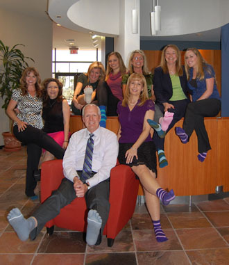 Carlsbad Chamber of Commerce goes a One Day Without Shoes in ToeSox.