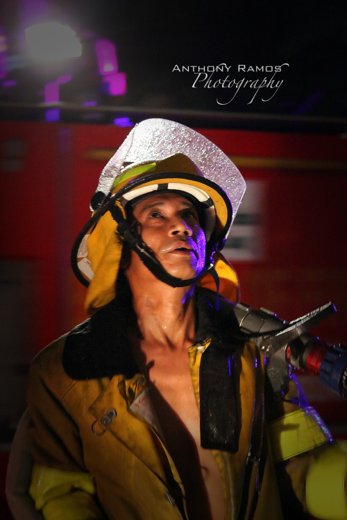 32/365. Tough Day To Be a Firefighter. On May 13 2010, the Marcos Justice Hall in Laoag City caught fire (for the second time in 5 years). Be it arson or pure karma for the corrupt legal system that pollutes the country, I honestly didn't care if the building burned down into a pile of rubble or not. At least no one was hurt. Sometimes the ridicule of a justice system of the Philippines just makes me want to puke. This fireman on the other hand, did his job accordingly. But if I were in his shoes, I'd be putting out the fire yet in my dastardly thoughts, I'd be giggling. Camera Info: Canon 50D | 24-70mm L USM | Ƒ/2.8 | ISO 3200 | 1/25s  © Copyright Anthony R. Ramos, 2010. All rights reserved. Unauthorized use of pictures or text within this page is punishable by law.
