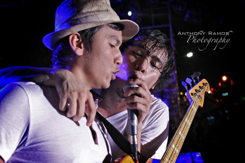 34/365. Wooing The Player. Callalily lead singer Kean Cipriano urges bassist Aaron Ricafrente to up the ante as they reach the climax of the concert. Camera Info: Canon 50D | 24-70mm L USM | Ƒ/2.8 | ISO 3200 | 1/50s   © Copyright Anthony R. Ramos, 2010. All rights reserved. Unauthorized use of pictures or text within this page is punishable by law.
