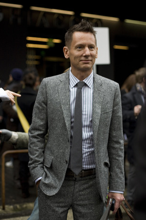 mrsartorial:  Jim Nelson, Editor-in-Chief of GQ out on the street and living the lifestyle. I'm definitely liking this tweed and solid gray tie combo; keeping it simple and classy. prepidemic:  Nice and Casual   This is a wonderful example of a dressed-down suit.  This look would fly  in most business-casual contexts, with its relatively casual fabric and  simple styling.  It could also work in a more formal creative  professional's wardrobe - say a designer or an ad executive.  Besides  all that, he looks great, right?