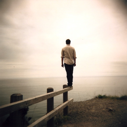 jhpearce:  On the rail off the Coastal Drive, CA.  OMHolga via Suza.  I'm a total Holga novice, but sometimes I get lucky, like with the above shot. It probably helped that my subject has such good balance (and didn't know I was taking this photo). After years of lazy point-and-snap-and-delete-and-try-again digital photography, it's been fun getting back into film photography. And the crap-shoot Holga experience makes the anticipation of getting your prints back even more exciting. I haven't added this recent roll to Flickr yet, but you can lookit a couple sets of my early Holga photos there now if you wanna.