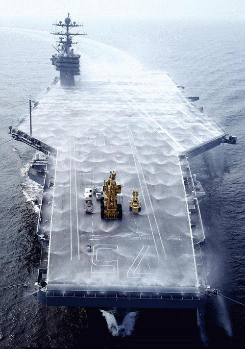 "shirokuma001:  baikuken:  xplanes:  ""USS Harry S. Truman (CVN-75) tests her washdown system during sea trials off the Virginia Capes, June 24, 1998"""