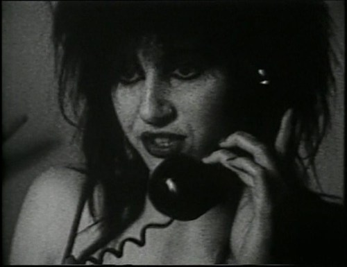 "Lydia Lunch in Richard Kern's Fingered (1986) (via lulublanche, italiawasteland) When I was a dawdling young whipperslapper whose ur-aesthetic somehow became Patricia Morrison in the This Corrosion video clip (the rather less vulgar Danielle Dax came a little later), I became desperately torn between wanting to be Lydia Lunch and wanting to be a Robert Palmer girl. Or rather, wanting to look like either. Not the most compatible of aspirations, and never shall the twain meet when the only thing they seem to have in common is a penchant for zealous eyeliner application and exhibitionism, but I was an odd child who considered her first viewing of The Labyrinth some kind of paroxysmic erotic awakening. Given that despite their smoky-eyed mousse-headed aura of fembotty and slightly castrating awesomeness - and I still love them, bless their fragmented-by-montage disjointed bodycon-clad all-girating body parts - Robert Palmer girls have very little agency of their own (to state the no-what-Joe-Eszterhas-isn't-really-feminism's-most-eager-advocate-no-really-surely-you-jest obvious), and, like crotch-shot-popping Busby Berkeley chorus girls whose fetishised identical compliant bodies can only perform together as a somewhat sinister single unit, they similarly only ever exist as a collective de-individualised image of scopophilic male fantasy par excellence, it's rather a good thing that Lydia eventually won. …That was an exceedingly long sentence. I'm a bit of a ranting mess this week, rendered all cantankerous Angry Young Woman by this Australian election bollocks. Never mind that I'm so puerile I giggle like a schoolgirl every time the phrase ""hung parliament"" is used."