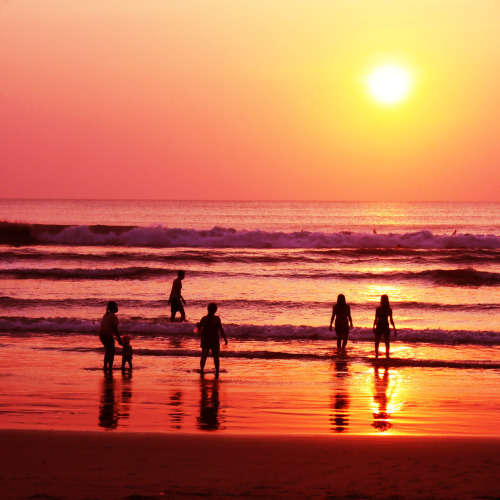 Sunset in Kuta Beach, Bali. With a long broad Indian Ocean beach-front, Kuta was originally discovered by tourists as a surfing mecca. It has long been a popular stop on the classic backpacking route in South East Asia. Back in the 1980s they used to talk about the three Ks: Katmandu in Nepal, Khao San road in Bangkok and Kuta. Today Kuta still attracts some hardcore backpackers as well as families and tourists from all over the world, and is most notably a playground for young visitors from Australia. Due to the ever increasingly popularity of Bali, Kuta is continually developing, and is not short of unsightly, poorly planned buildings. It can come across at times to be chaotic, overcrowded and congested. However, amongst all the mayhem this place somehow works, and hundreds of thousands of visitors enjoy their time in Kuta every year. WikiTravel I want to walk into the sunset with you k. Kuta beach, Bali - Indonesia via inqrid Another Sunset in Kuta Bali