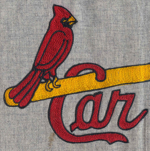 wellplaid:  The only MLB team to still wear a chain stitched jersey.  Easily my favorite MLB logo.  I have a 40s-style Cards hat with the birds and the bat from the late, lamented Cooperstown Ballcap Co. and it's one of my favorite garments.  The chain stitching here is absolutely lovely.