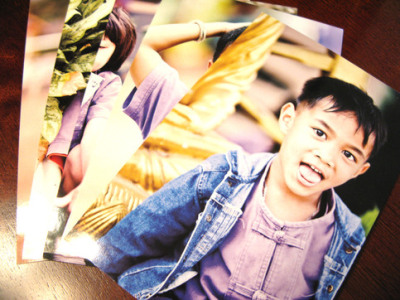 Thai Children Photo Postcards (Set of 5) Set of 5 photo postcards featuring Thai school kids from the village in Chiang Rai where The SOLD Project operates their prevention program. These are the faces of children who, thanks to the work of SOLD, have hope for a brighter future. Photos by Daniel Showalter. Postcards ship in 2-3 business days. Glossy photo-finish front and a matte finish back with areas for good ol' fashioned postcard writing and an address. Help spread the word about ways to prevent child prostitution! All profits go to support Heather & Michael Colletto's work with The SOLD  Project in Thailand. Order yours today.