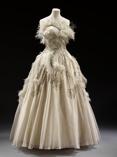 What Balmain used to be… White silk organza with ostrich feathers and rhinestones evening dress from between 1950 and 1955.