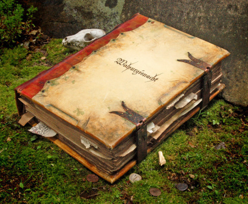 "Walpurgisnacht, the handbook  (a prop, not a real book this time)  ""In May I created a prop book for a movie currently in production. … The working title for the film is ""The House at the End of the Lane."" It's set in the first half of the 20th century, starting out in 1918. It has elements of horror, occult, and mystery, but basically it's a tragedy—the story of a man who has lost something so dear to him he will go to any lengths to regain it. He eventually sets in motion a series of events that leads to a catastrophe far worse than his original loss.""  ~Ross MacDonald  ""Here are a couple of lines from the script:  At times, it has the smell of living death—like gangrene in a hospital ward. At other times, its leather binding seems new. I mentioned that the cover … is leather. Well, that may be true—it may not. I believe the cover is human. Skin, Mr. Chambers""  B-A note: What a fun job!  (And the movie sounds fascinating as well.)  The article at tor.com contains more images of the book and a narrative of how he created it.  (""I was all out of human skin, so goatskin had to suffice."")"