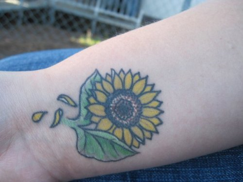 This sunflower was my third tattoo. Sunflowers remind me of my aunt Fredella who passed away when I was in middle school I was very close to her.I got the sunflower to carry her with me and never forget how much of a life she lived and the impact she had on me. The three falling petals also represent loved ones lost. My dad. My Grandpa O and my Grandma R. Never will I forget  them. Ink done by Kenny @ 805 Ink… Hes great and has so far done all of my tattoos.