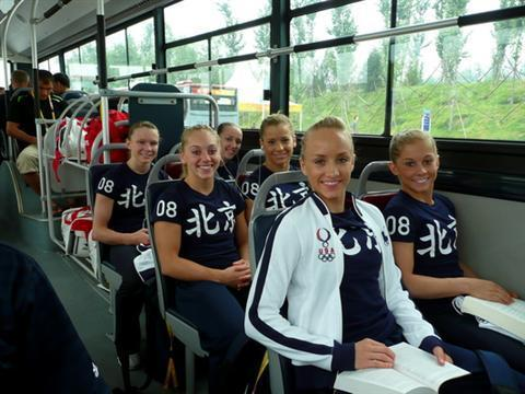 on the bus with the team at the 2008 Olympics, sharing a seat & reading with Nastia :) ending with a classic! photospams are entirely too much fun, sry guise.