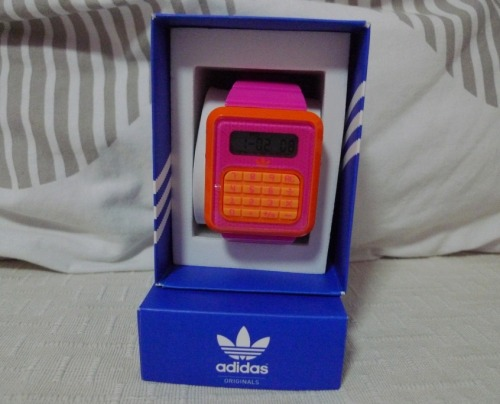 and my sister bought this uber-cute pink-orange watch from adidas with the calculator face!