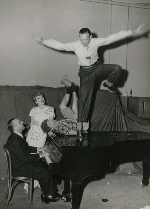 Fred Astaire, Harpo Marx, Lucille Ball, & Jose Iturbi  rehearse the routine they will put on for troops during the WWII USO tour (via)
