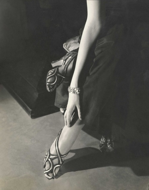 onebadapple:  [photo by Edward Steichen - Princess Nathalie Paley wearing  sandals by Shoecraft, 1934 Gelatin silver print Courtesy Condé Nast  Archive, New York © 1934 Condé Nast Publications]