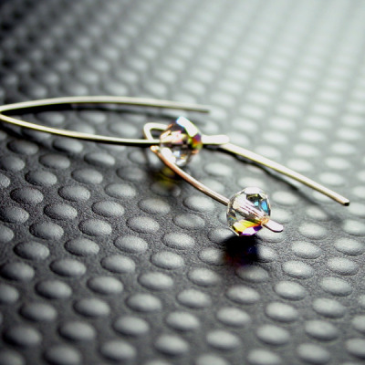 Just added Nixie Modern Silver Earrings with solo Aurora Borealis Crystals on Arced Hooks - Small. The crystals are brilliantly bicone beads - the cut creates a shape similar to an old fashioned spinning top. http://www.etsy.com/listing/50067801