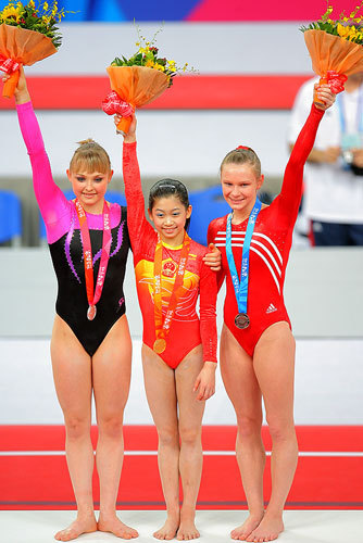 Bridget Sloan on the all-around podium with Daria Joura & Jiang Yuyuan at the 2007 Good Luck Beijing Invitational (pre-Olympic test event)