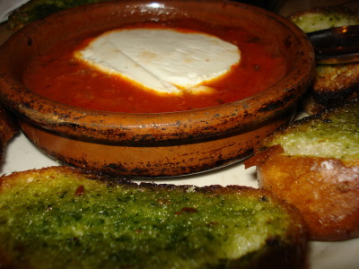 Queso de Cabra al horno from Cafe Iberico Warm goat cheese in a spicy tomato sauce served with crunchy pieces of toast.  This is the first time I've had queso de cabra from a tapas place where they served pesto toast as the dippers.  I really enjoyed the extra flavor it added to the dish.