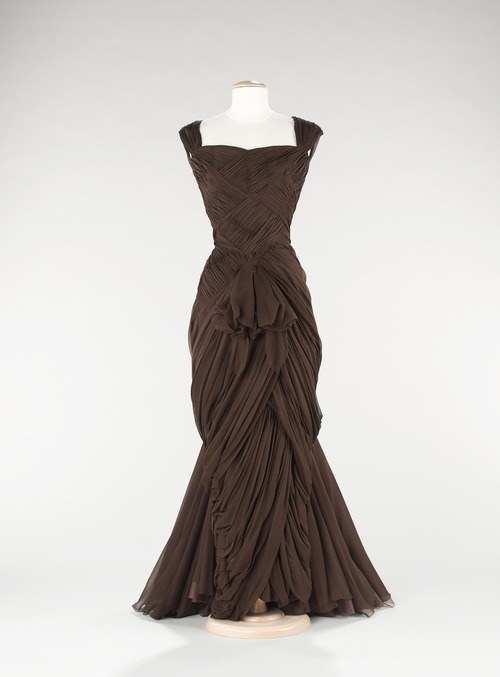 yeoldefashion:  This incredibly draped and gathered evening gown was designed by Jean Dessès in 1960. Vintage Jean Dessès gowns have made occasional appearances on the red carpet in recent years, worn by celebrities including Renée Zellweger and Jennifer Lopez.