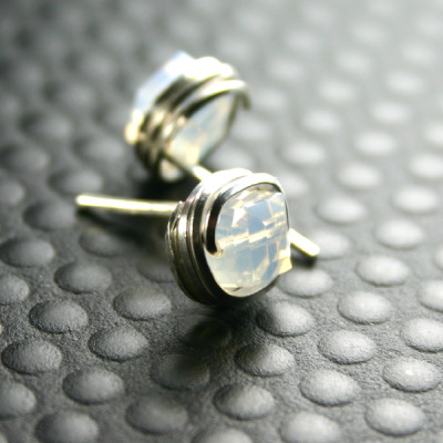 New design - crystal cube studs wrapped with square wire.  The crystal are white opal wrapped in sterling silver