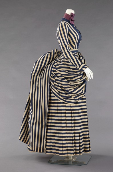whattheywore:  This dress from between 1885 and 1888 would have been worn for tennis, yachting or general  seaside walking.  Striped textiles were fashionable for such activities,  probably due to the nautical theme. Although the silhouette remained the same, with the exception of  the shorter, more maneuverable length, the trimmings were reduced.   This is a striking example of this type of dress, which is fairly rare  in museum collections. (Met Museum)